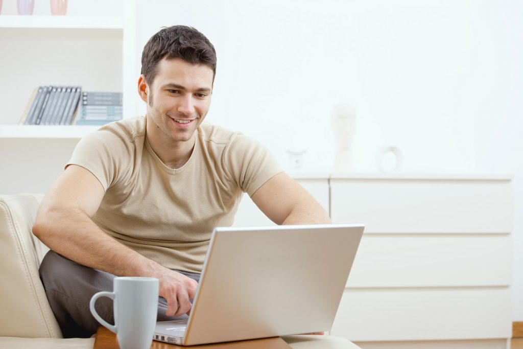 Man at home on laptop